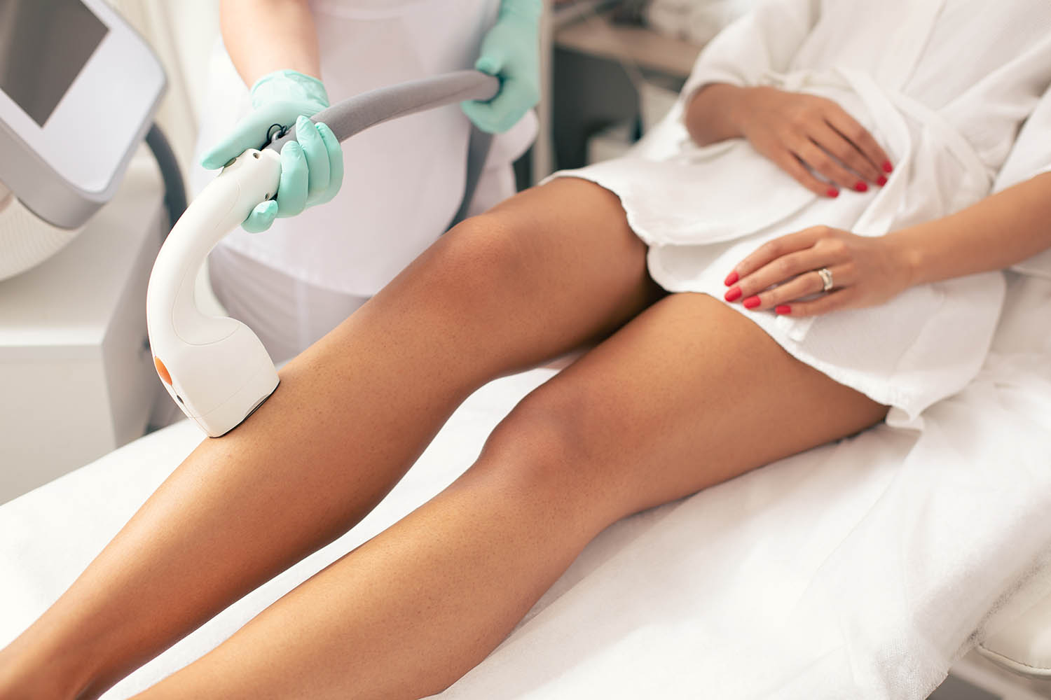 Close up of the medical worker conducting laser hair removal with a vacuum suction